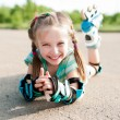Foto Stock: Little girl in roller skates