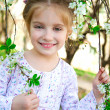 Little girl with bush blossoming — Stock Photo #10572000