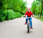 Girl with bicycle — Stock Photo