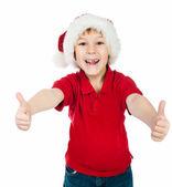 Noel baba şapkalı küçük çocuk — Stok fotoğraf