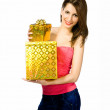 Pretty young woman with gifts — Stock Photo