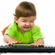 Little child holding keyboard — Stock Photo