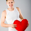 Cute young menl with a red heart — Stock Photo