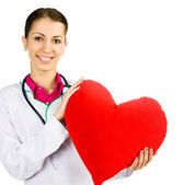 Doctor taking care of red heart symbo — Stock Photo