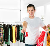 Men with packages shopping — Stock Photo