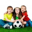 Foto de Stock  : Small kids with soccer ball