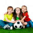 Foto Stock: Small kids with soccer ball