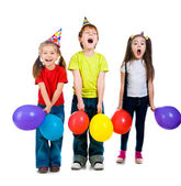 Kids in birthday caps — Stock Photo