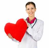 Doctor cuidando de corazón rojo symbol — Foto de Stock