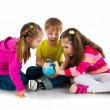 Kids with a globe of the world — Stock Photo #8619247