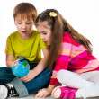 Kids with a globe of the world — Stock Photo