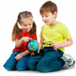 Kids with a globe of the world — Stock Photo #8666751