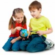 Kids with a globe of the world - Foto de Stock