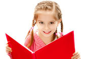 Little girl reading a book — Stockfoto