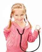Little girl with stethoscope in hand — Stock Photo