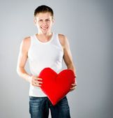 Cute young men with a red heart — Stock Photo