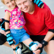 Stock Photo: Dad with his daughter on the skates