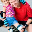 Dad with his daughter on the skates - Foto Stock
