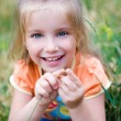 Cute little girl on the meadow — Stock Photo #9418195