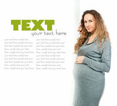 Pregnant woman caressing her belly — Stock Photo