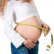 Pregnant woman measures her stomach — Stock Photo