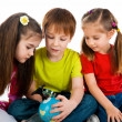 Kids with a globe of the world — Stock Photo #9458142