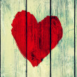 Love symbol on old wooden wall — Stock Photo
