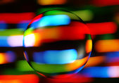 Abstract colorful background with a transparent sphere — Stock Photo