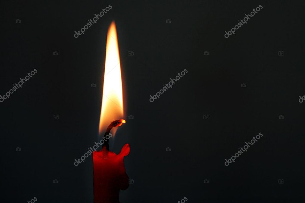 Burning red candle in the dark — Foto de Stock   #8615247