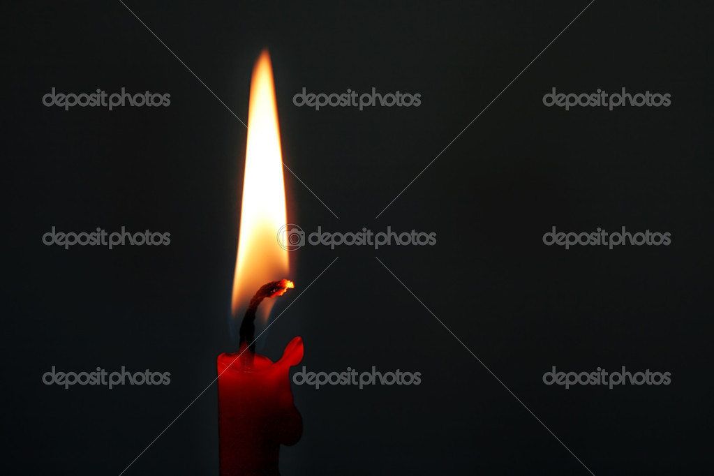 Burning red candle in the dark  Photo #8615247