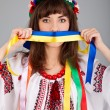 Cute Ukrainiwomwith blue yellow band on mouth — Stock Photo #8875343