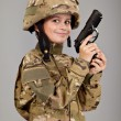 Young boy dressed like a soldier with a gun — Stock Photo #8889563