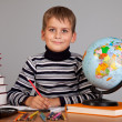 Foto Stock: Cute schoolboy is writting