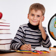 Cute schoolboy is writting — Stok Fotoğraf #8900345
