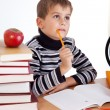 Cute schoolboy is thinking - Stock Photo