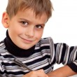 Cute schoolboy is writting — Stock Photo #9848786