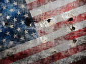 Holed grungy American flag background. — Stock Photo