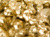 Gold texture closeup background. — Stock Photo