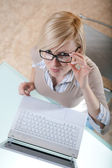 Woman in glasses with laptop — Stock Photo