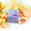 Stock Photo: Roses petal and box for golden rings