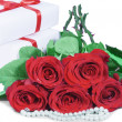 Roses and gift box — Stock Photo