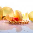 Rose petals and pearl necklace - Stock Photo
