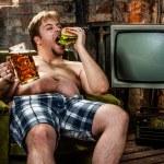 Fat man eating hamburger — Stock Photo #10188499