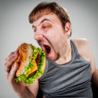Fat man eating hamburger — Stock Photo #10188504