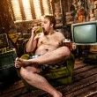 Fat man eating hamburger — Stock Photo #10451885