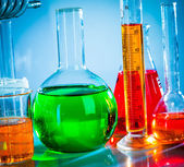 Test tubes with colorful liquids — Stock Photo