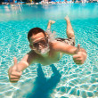 Teenager floats in pool — Stock Photo