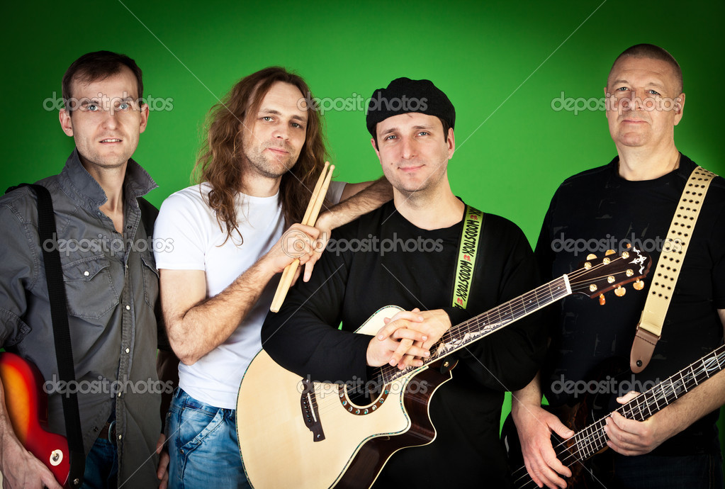 Musical group of artists on a green background — Stock Photo #8515134