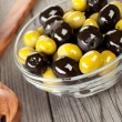 Olives on a wooden table - Stock Photo
