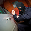 Robber and the thief in a mask hijacks the car — Stock Photo #9015136